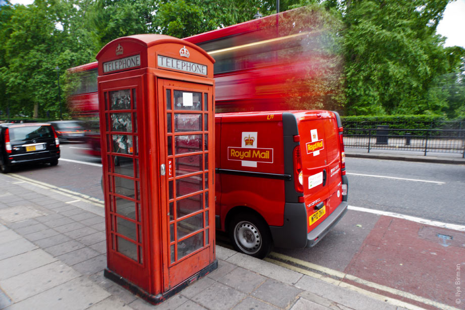 A phone booth, a Rolay Mail van and a bus in London