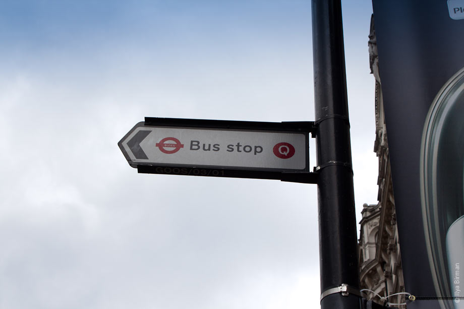 London bus stop with a letter code Q