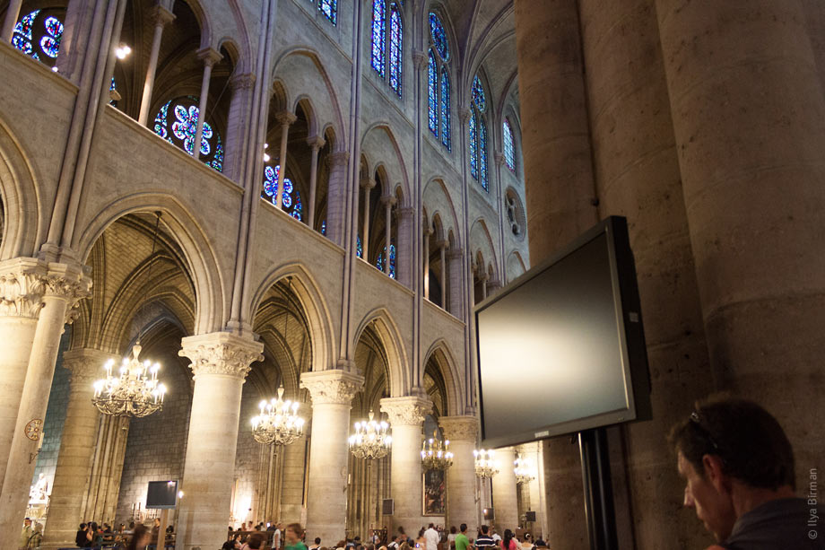 Plasma display panels are mounted to the walls of Notre Dame de Paris