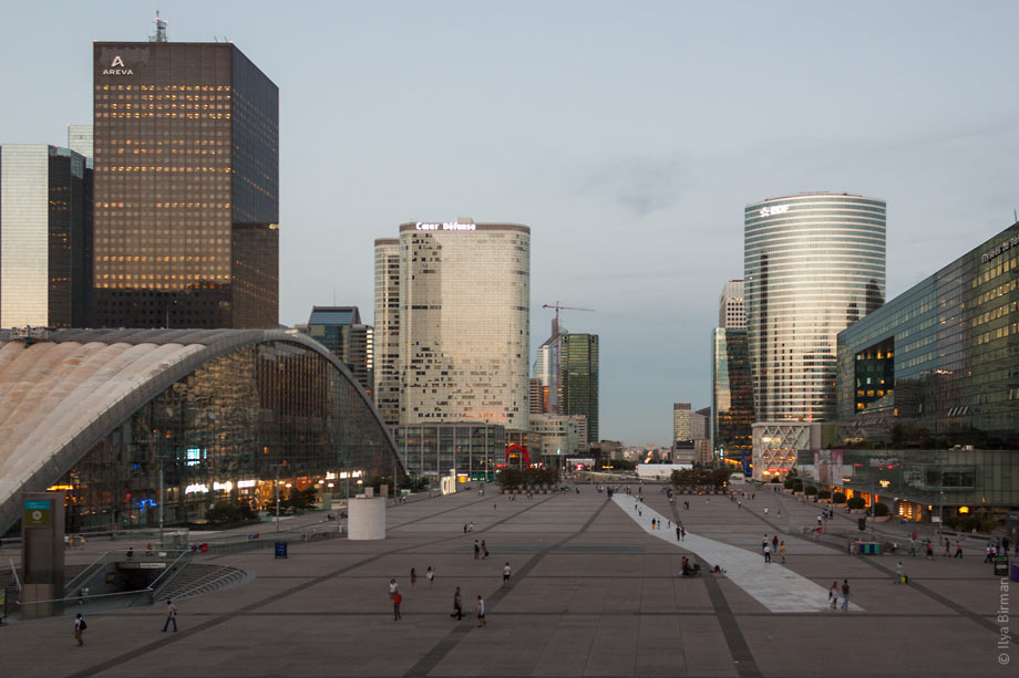 In front of the Grande Arche in Paris, there is a square with a huge white stripe